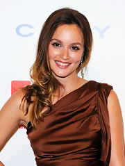 Leighton Meester styled her brunette tresses in side swept curls at the DKMS' 5th Gala.