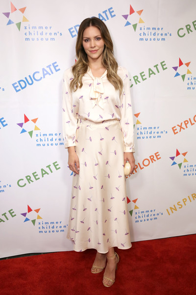 Katharine McPhee Print Dress [clothing,red carpet,dress,hairstyle,yellow,carpet,fashion,long hair,premiere,flooring,katharine mcphee,los angeles,california,skirball cultural center,zimmer childrens museum discovery award dinner]