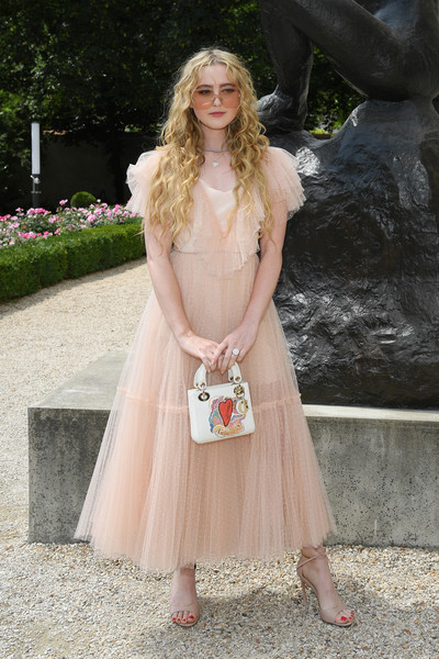 Kathryn Newton Printed Purse [clothing,white,dress,pink,lady,blond,beauty,fashion,gown,long hair,christian dior,kathryn newton,part,paris,france,christian dior haute couture fall winter 2018,photocall - paris fashion week,show,paris fashion week]