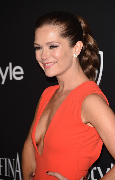 Katie Aselton Long Braided Hairstyle [hair,hairstyle,beauty,chin,premiere,brown hair,dress,long hair,smile,bun,post-party - arrivals,katie aselton,beverly hills,california,the beverly hilton hotel,instyle,warner bros. 72nd annual golden globe awards,warner bros. 72nd annual golden globe awards post-party]