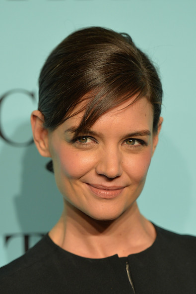 Katie Holmes Chignon [katie holmes,tiffany debuts,tiffany debut,blue book,hair,face,eyebrow,hairstyle,forehead,chin,head,lip,cheek,beauty,new york,guggenheim museum,united states]