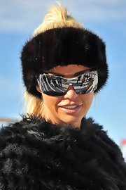 Kate Price was paired her snow bunny gear with reflective shield sunglasses.