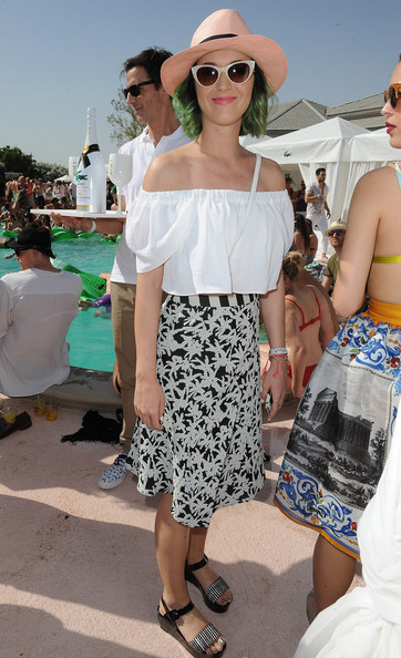 Katy Perry Knee Length Skirt [shoulder,sunglasses,fashion,joint,vision care,leg,trunk,eyewear,girl,summer,katy perry,thermal,california,moet chandon ice imperial debuts,the lacoste beautiful desert pool party,debut,lacoste beautiful desert pool party]