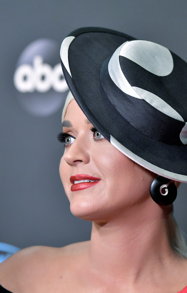 Katy Perry Costume Hoops [american idol,american idol finale,clothing,hat,beauty,lip,fashion accessory,headgear,costume accessory,costume hat,headpiece,smile,arrivals,katy perry,california,los angeles,abc]