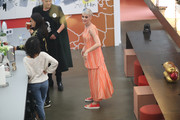 Katy Perry kept it comfy all the way down to her red slip-ons.