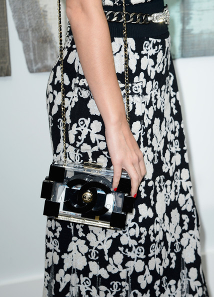 Katy Perry Chain Strap Bag [show,clothing,white,black,dress,black-and-white,fashion,shoulder,monochrome photography,waist,footwear,katy perry,front row,part,bag detail,grand palais,paris,france,chanel,paris fashion week womenswear spring]