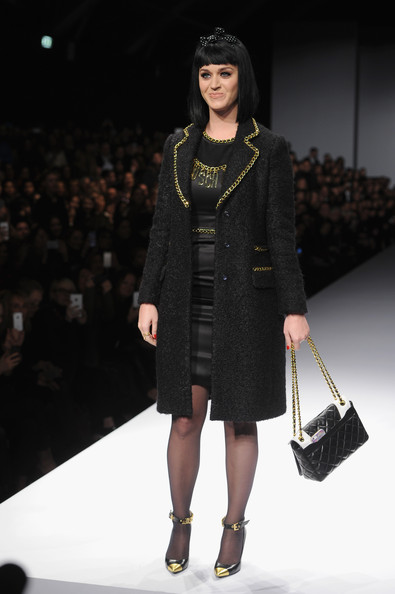 Katy Perry Quilted Leather Bag [show,fashion model,fashion show,runway,fashion,clothing,fashion design,public event,event,coat,outerwear,katy perry,milan fashion week womenswear autumn,front row,part,milan,italy,moschino]