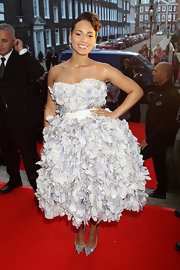 Alicia was ravishing in a petal-covered cocktail dress with a retro, waved updo.