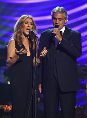 Celine Dion sported red nail polish of a subtle pop of color to her black outfit.