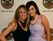 Kacey Musgraves styled her lavender dress with a layered beaded necklace for the 'We're All 4 the Hall' benefit concert.
