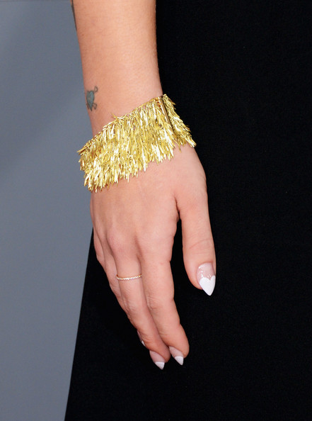 Kelly Osbourne Gold Bracelet [bracelet,finger,jewellery,yellow,hand,bangle,fashion accessory,fashion,nail,joint,arrivals,kelly osbourne,fashion detail,california,los angeles,staples center,55th annual grammy awards]