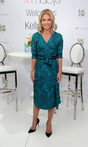 Kelly Ripa kept it classic in a teal wrap dress during the launch of her Home Collection for Macy's.
