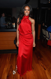Kelly Rowland gave her look an unexpected element by pairing her romantic flowing red dress with bright white strappy sandals.