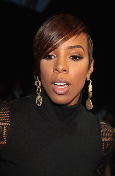 Kelly Rowland Emo Bangs [hair,face,hairstyle,eyebrow,lip,beauty,chin,forehead,black hair,cheek,roberto cavalli,kelly rowland,part,roberto cavalli - backstage front row,milan,italy,milan fashion week womenswear autumn,fashion show]