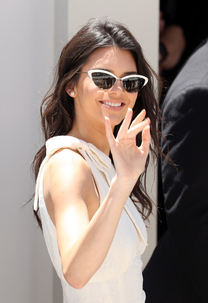 Kendall Jenner Cateye Sunglasses [eyewear,sunglasses,hair,white,cool,glasses,beauty,hairstyle,vision care,lip,kendall jenner,ambassador,magnum beach,cannes,france,magnum global,photocall - the 69th annual cannes film festival,photocall]