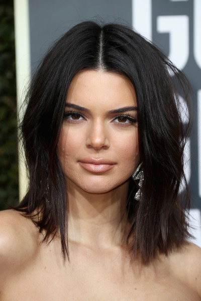 Kendall Jenner Nude Lipstick [hair,face,eyebrow,hairstyle,black hair,chin,lip,beauty,shoulder,layered hair,arrivals,kendall jenner,the beverly hilton hotel,beverly hills,california,golden globe awards,annual golden globe awards]