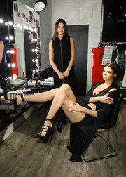 Kendall Jenner stopped by Madame Tussauds wearing a cute zip-front LBD.