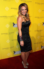 Hilary shined at the Kendra Scott jewelry launch in a gunmetal strapless dress.