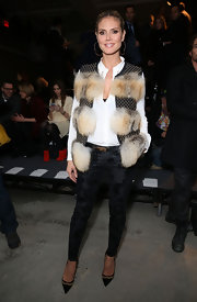 Heidi rocked a fur-clad studded leather vest for the Kenneth Cole Fall 2013 show.
