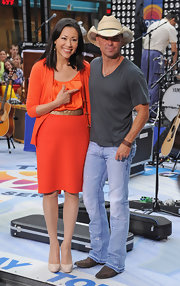 Ann Curry brightened up the 'Today' show with her orange ensemble, consisting of a cardigan, blouse, and pencil skirt.
