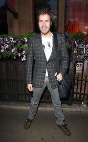 Perez Hilton's colorful sneakers echoed the pattern of his jacket.