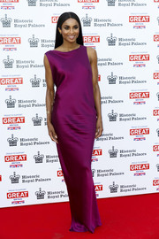 Ciara went for a sleek and elegant red carpet look in a fuchsia column dress by Stella McCartney during the Kensington Palace Summer Gala.