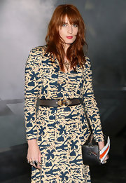 Florence Welch toughened up her printed dress with a studded leather belt.