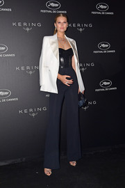 Toni Garrn polished off her look with a white tux jacket.