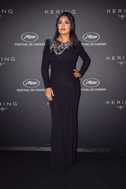 Salma Hayek cut a sophisticated figure in a black Alexander McQueen gown with a bejeweled neckline at the Kering Women in Motion Awards.