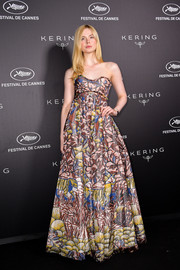 Elle Fanning looked festive in a painterly strapless gown by Dior at the Kering Women in Motion Awards.