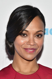 Zoe Saldana was elegantly coiffed with this side chignon at the GLAAD Media Awards.