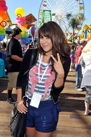 Daniella Monet topped her striped tee with a chic black velvet blazer.