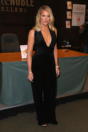 Khloe Kardashian was sexy and sophisticated in a plunging black jumpsuit by Balmain during her book signing.