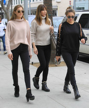 Sophia Rose Stallone was edgy in a studded, split-sleeve sweater and matching skinny jeans while out on a stroll.