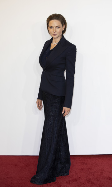 Rebecca Ferguson teamed shimmering navy palazzo pants with a fitted blazer for the gala screening of 'The Kid Who Would Be King.'
