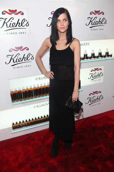 Leigh Lezark maintained her monochromatic look with a black leather clutch.
