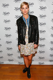 Leigh Lezark paired an oversized leather jacket over her floral dress for a cool mix of masculine and feminine styles.