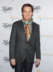 Kyle MacLachlan added some color to his gray blazer with a printed scarf.