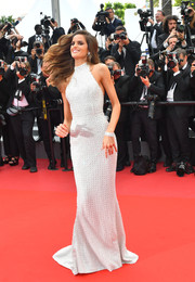 Izabel Goulart hit the Cannes Film Festival premiere of 'The Killing of a Sacred Deer' wearing a curve-hugging silver halter gown by Ralph & Russo.