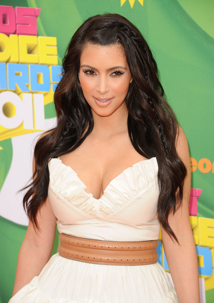 long curls to the side. Kim Kardashian Long Curls