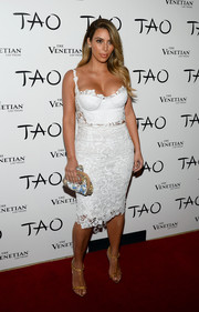 Kim Kardashian was almost bursting out of her white Dolce & Gabbana corset top during her birthday party at Tao Nightclub.