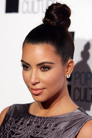 Kim Kardashian wore her hair pulled tight into a top knot during the E! Channel Brand Evolution event.