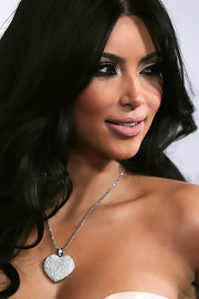 Kim Kardashian add a dash of bling to her look with a diamond heart pendant neckalce.
