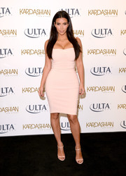 Kim Kardashian looked very curvy, as always, in a tight-fitting nude dress while promoting Sun Kissed.