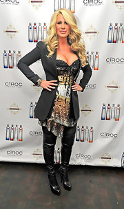 Kim Zolciak was a bondage babe at her Ciroc New Year party in black leather over-the-knee boots.