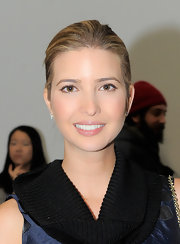 Ivanka Trump attended the Kimberly Ovitz fall 2012 fashion show looking fresh-faced and wearing a touch of super-shiny lip gloss.