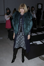 Anna Wintour kept her look polished and sophisticated with a printed skirt at the Kimberly Ovitz runway show.