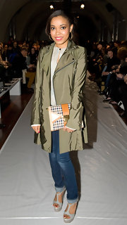 Dionne Bromfield attended the Kinder Aggugini show in a stylish olive green trenchcoat.