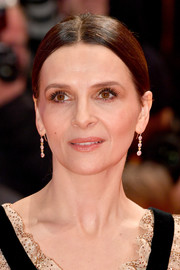 Juliette Binoche opted for a simple center-parted ponytail when she attended the Berlinale premiere of 'The Kindness of Strangers.'
