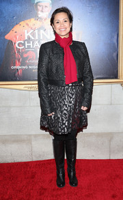 Lea Salonga bundled up in a textured black leather jacket and a red scarf for the Broadway opening of 'King Charles III.'
